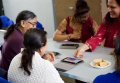 Community members at the Adhar Project learn how to use their new tablet computers