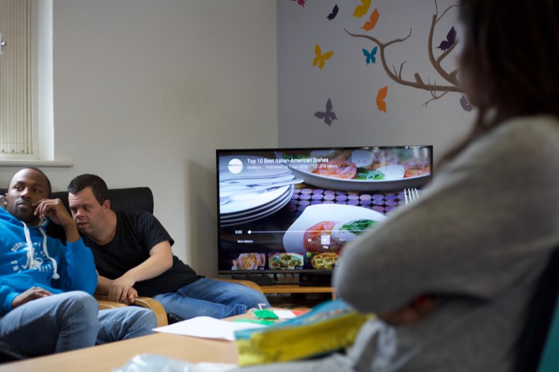 SOLO members w learning disabilities enjoy their TV