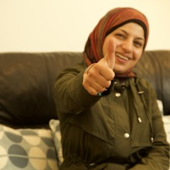 Helping: Refugee lady is pleased with her technology