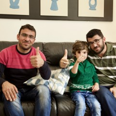 Families - dad, son and uncle give the camera a thumbs up