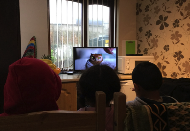 Children watching cartoons on their new TV