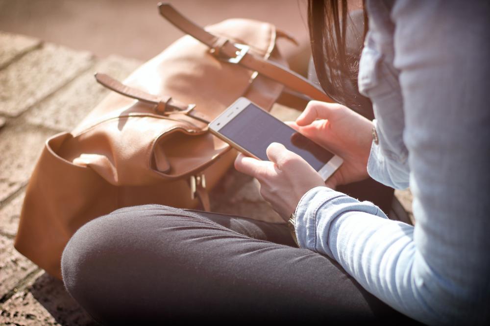 children online, teenage girl looks at phone