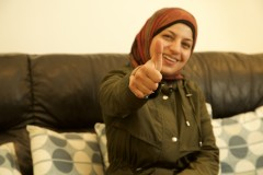 Refugee lady is pleased with her technology