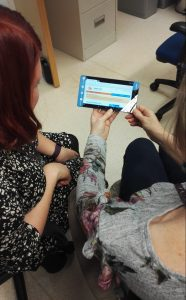 Donate - a survivor of domestic abuse learns to use her new WaveLength tablet