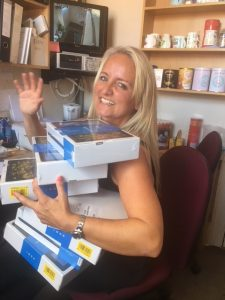 A referee holding the tablets destined for survivors of domestic abuse