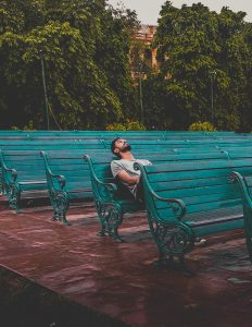 MSN - a man sits alone on a row of benches