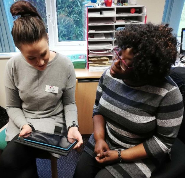 Two women using tablet