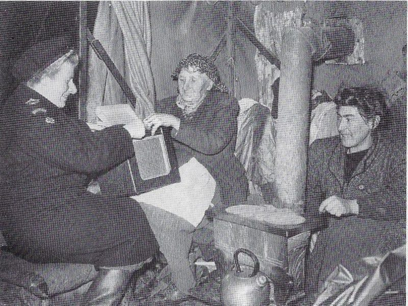 Our oldest photos are from the late-40s, early 50s. Miss Stable (far left), worked for the Devonshire Red Cross gave a wireless to Mrs Holland and her daughter. Likely homeless victims from war, they lived in a tent near Farway Common in Honiton.