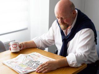 Tim reading newspaper