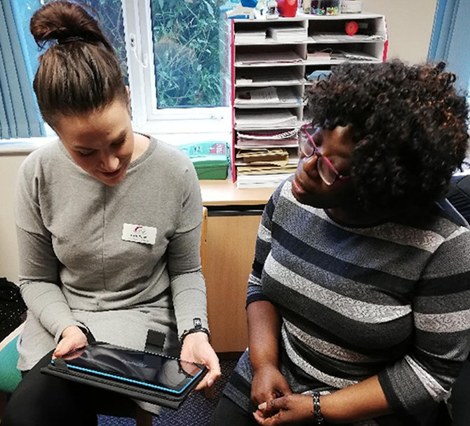 Women using WaveLength tablet