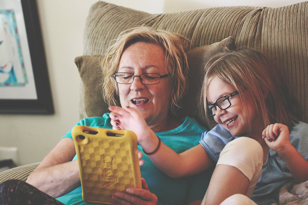 A parent and child using a tablet